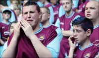 http://legionsports.files.wordpress.com/2011/05/west-ham-fans.jpg